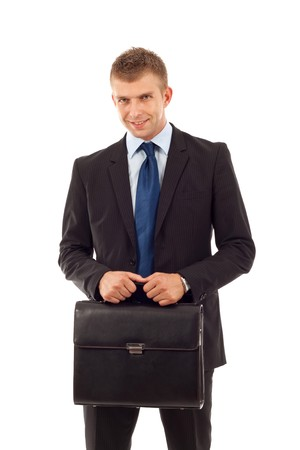 business man holding a  briefcase over white  photo