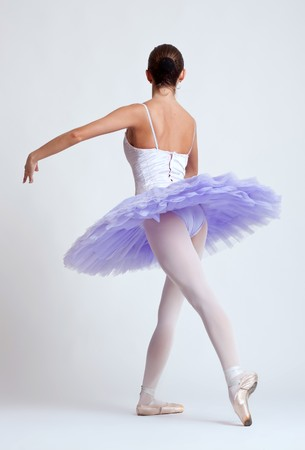 Ballerina dancing - Back view isolated over white  photo