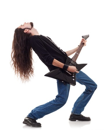 rock guitarist: Guitar player playing his guitar leaning back over white