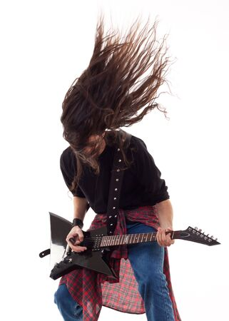 Electric guitar player on a white background playing the rock music  photo