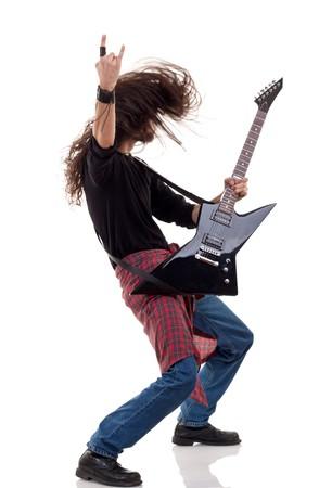 headbanging rocker plays guitar over white background Stock Photo - 8043158