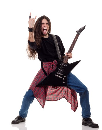 long haired guitarist is playing and making a rock hand gesture Stock Photo - 8043191