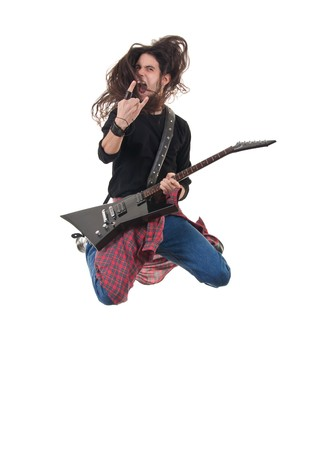 banging: heavy metal rocker jumps on a white background