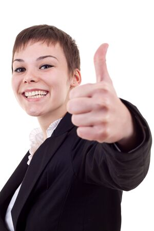 Thumbs Up! Studio partrait of young business woman showing OK sign, looking at camera and smiling. Isolated on white background photo