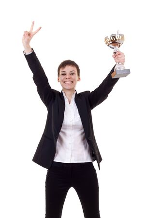 trophy winner: Portrait of an excited young business woman winning a trophy against white background