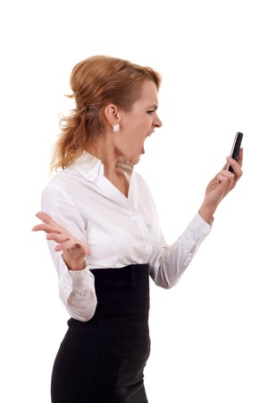 Angry Woman Yells At Cell Phone Isolated on a White Background.  photo