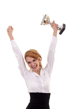Happy business woman showing her big trophy over white  photo
