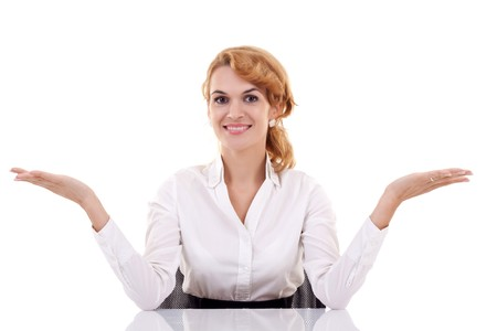 arms open: Young beautiful business woman behind the desk with open arms, isolated