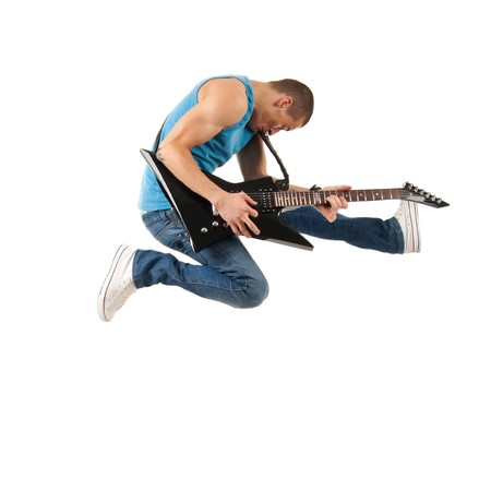 passionate guitarist jumps in the air over white photo