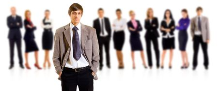 Business team with a male leader with hands in his pockets Stock Photo - 8198546