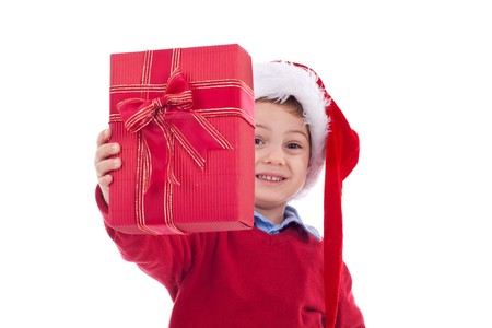 Small boy in Santas red hat offering Christmas present isolated on white  photo