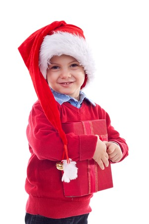 Small boy in Santas red hat holding a present  isolated on white  photo