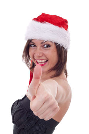 woman in red santa hat over white background , making ok hand gesture photo