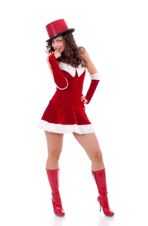Happy cute girl in santa claus suit over white , with finger in her mouth Stock Photo - 8410683