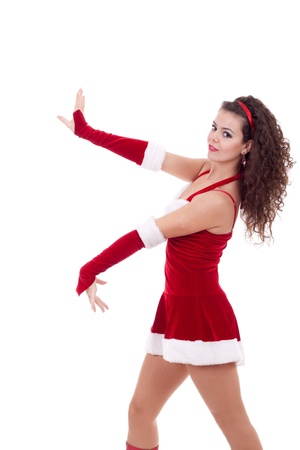 cloath: santa girl wearing christmas costume dances on a white background