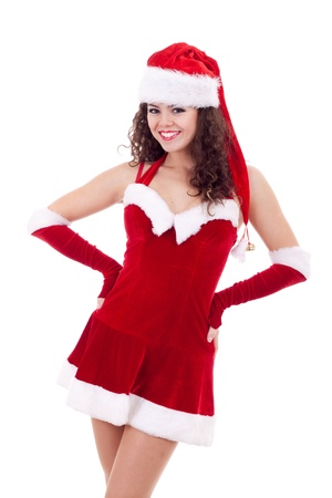 beauty girl in santa hat and dress over white background  photo