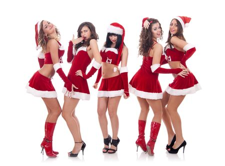 christmas girl: picture of a group of santa women talking and laughing Stock Photo