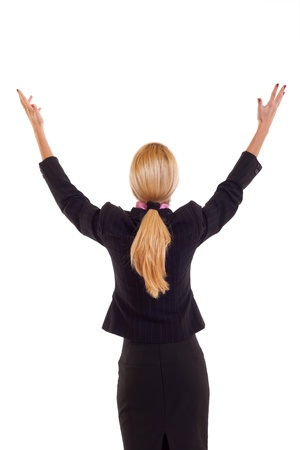 Back of business woman in black suit holding her hands in the air, isolated photo
