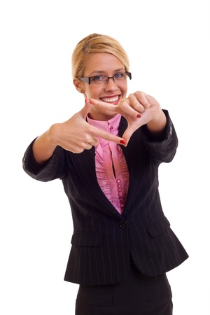 Happy business woman creates a frame with her hands, isolated  photo