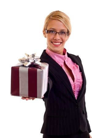Happy business woman holding a gift in her hand, isolated photo
