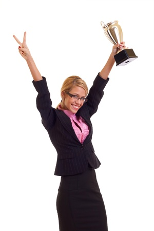 Happy business woman holding a trophy and making a victory gesture photo