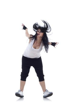 headbanging: woman dancer standing on her heels over white background Stock Photo