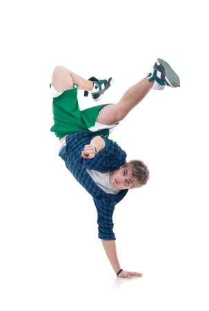 down beat: Young bboy standing on one hand. Holding legs in air. Looking and pointing at camera. Isolated on white in studio. Front view, whole body  Stock Photo