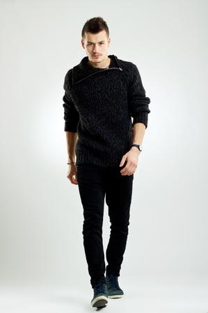 picture of a male fashion model wearing wool sweater, walking  photo
