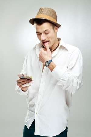 picture of a young Man Counting Romanian Money - studio shot photo