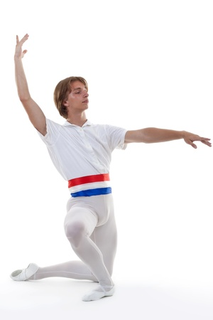 male ballet dancer kneal on a white background in a ballet pose  photo