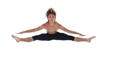 legs spread: immagine di un ballerino maschio con diffusione gambe saltando bianco Archivio Fotografico