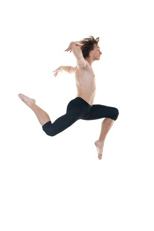 ballet dancer practicing high jumps over white background photo