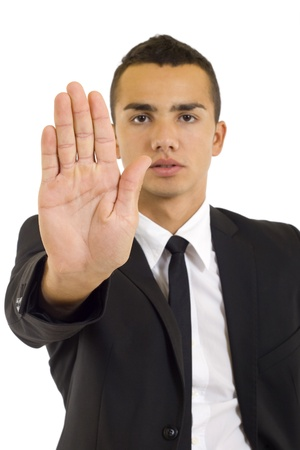 Serious business man making stop gesture, isolated photo