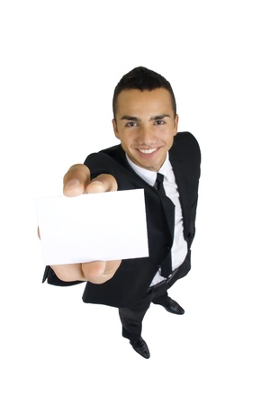 Blank business card in the hand of smiling business man, wide angle, isolated photo