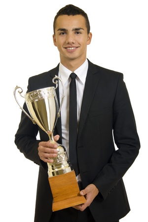 Business man holding a gold trophy, isolated  photo