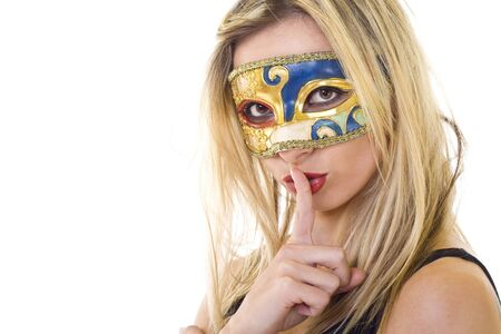 hushed: Woman in carnival mask making silence gesture over white Stock Photo