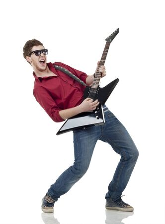 Rock star with a guitar screaming isolated over white background  photo