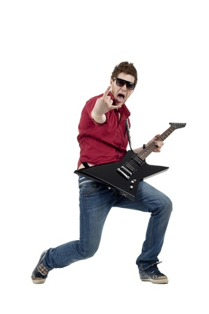 Handsome rock star playing the guitar gesturing rock sign, isolated Stock Photo - 8589884