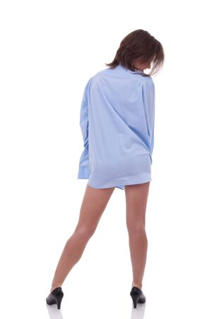 back picture of a woman wearing a man's shirt over white Stok Fotoğraf