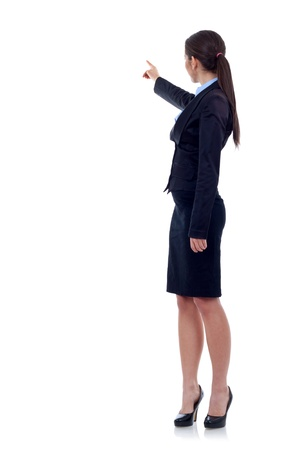woman back of head: Business woman points finger at something in her back. Isolated on white background