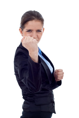 business woman on white getting into a fight - focus on fist photo