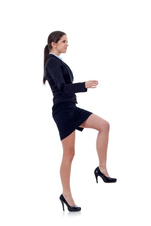 Young attractive business woman stepping on imaginary step Stock Photo - 8708730