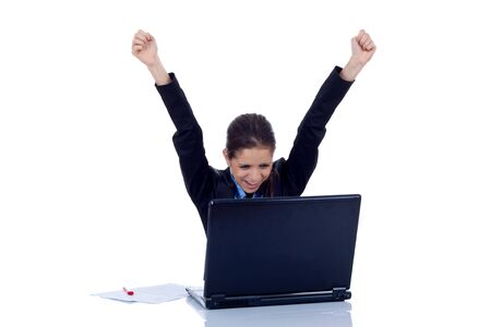 jubilation: Young woman in office jubilates at desk. Isolated on white background.