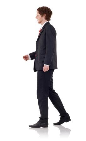 Knappe business man walking, op witte achtergrond