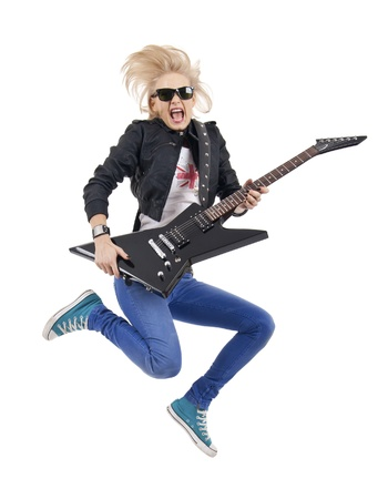 Rock star jumping and screaming, playing an electric guitar Stock Photo - 8708676