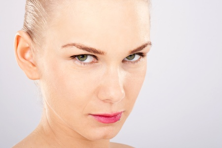Close up of o beautiful blonde woman with green eyes photo