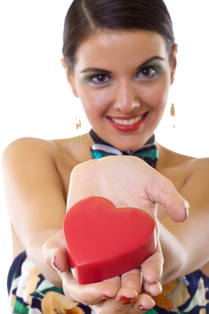 wide angle of a beautiful woman holding a big red heart  photo