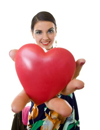 beutiful young woman handing a big red heart over white - wide angle shot photo