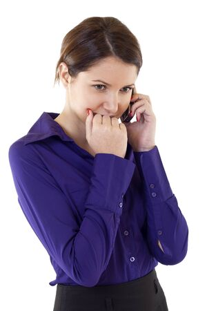 Worried business woman talking on her mobile phone Stock Photo - 8850339