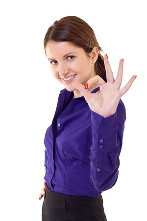 Young business woman indicating ok sign. Isolated over white background  photo